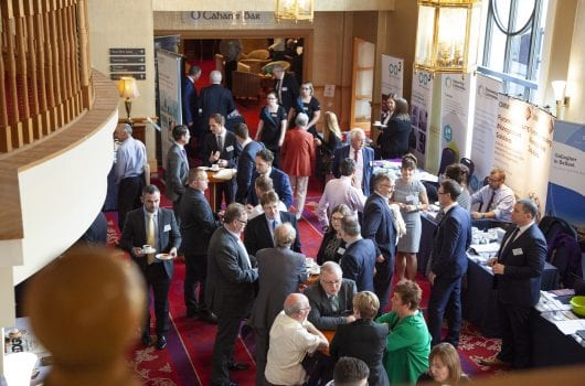 People mingling during a NIFHA conference coffee break