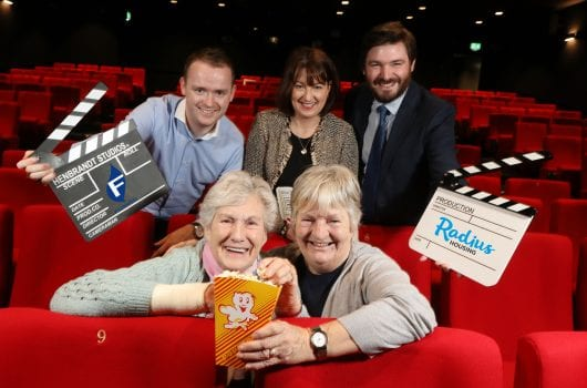 3 women, 2 men with clapperboards and popcorn in old-fashioned cinema